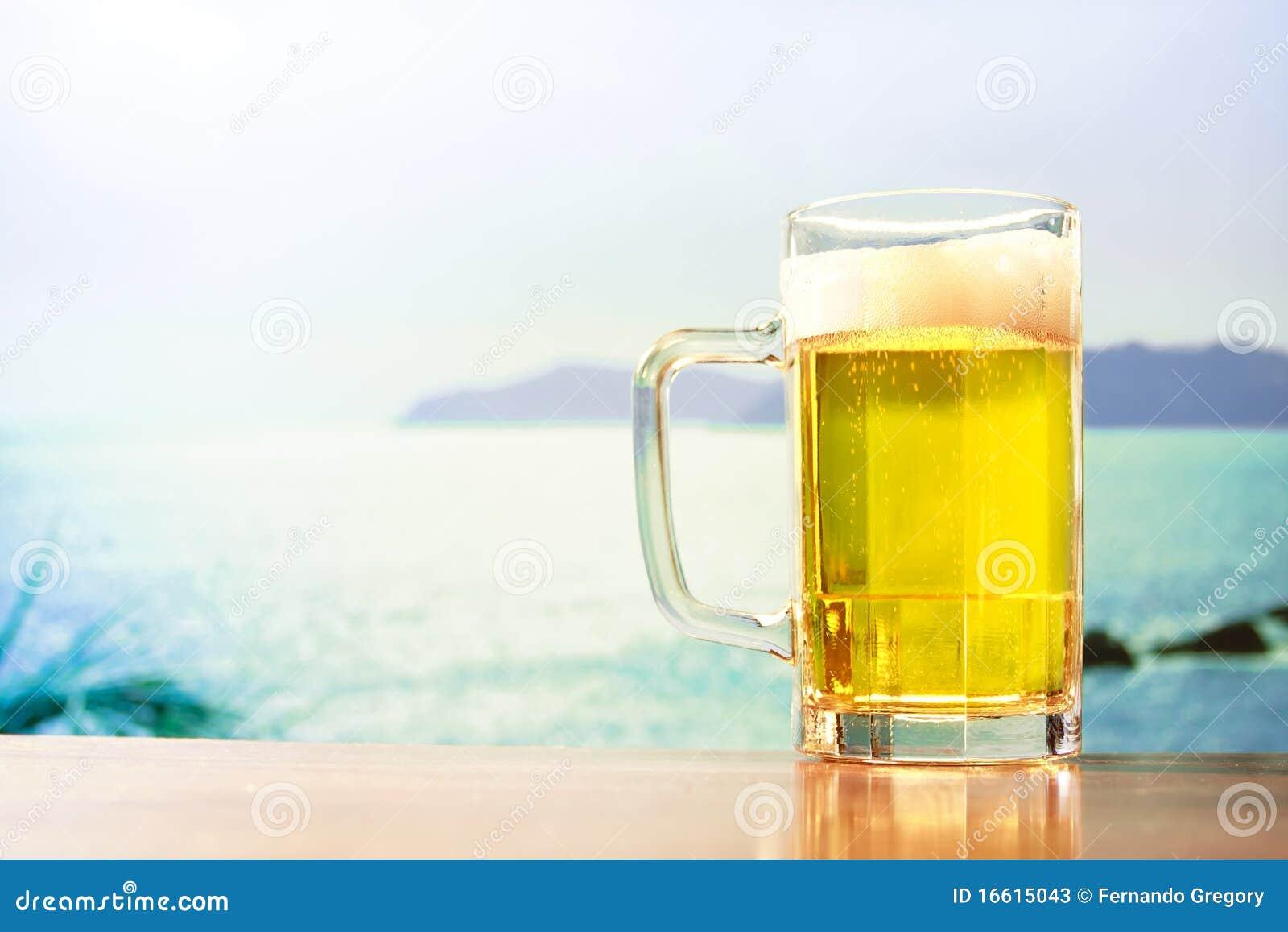 Refreshing Beer Mug On The Beach Stock Photos Image