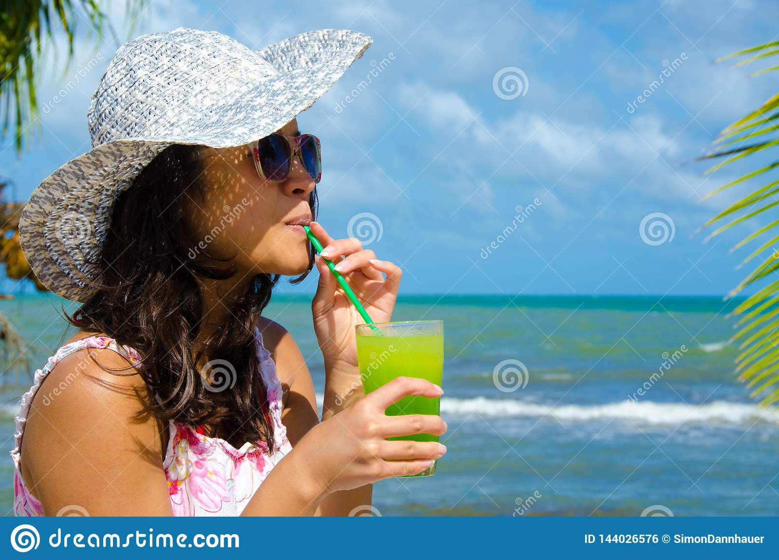 Refreshing Cocktail at beach in Belize - recreation in tropical destination for vacation - paradise coast