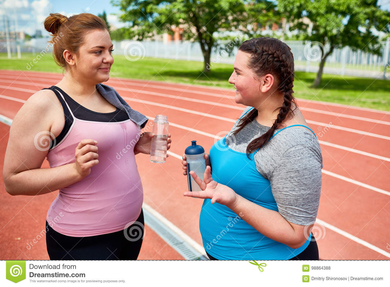 Refreshment and talk stock photo  Image of talking, workout - 98864388
