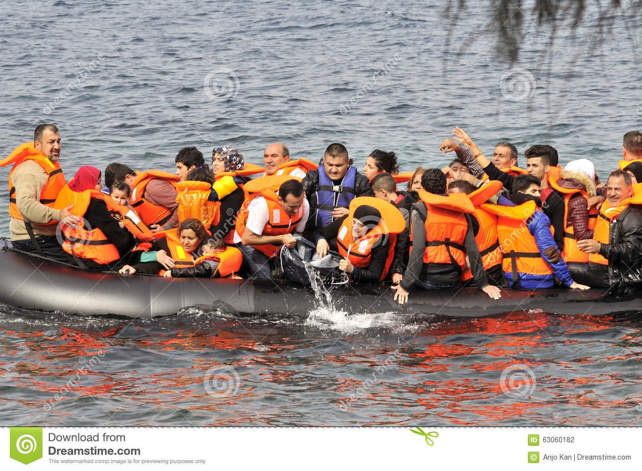 Refugees arriving in Greece in dingy boat from Turkey