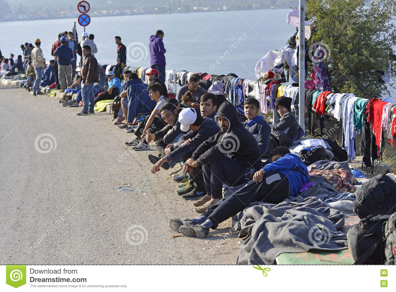 Refugees sittng on the street Lesvos Greece