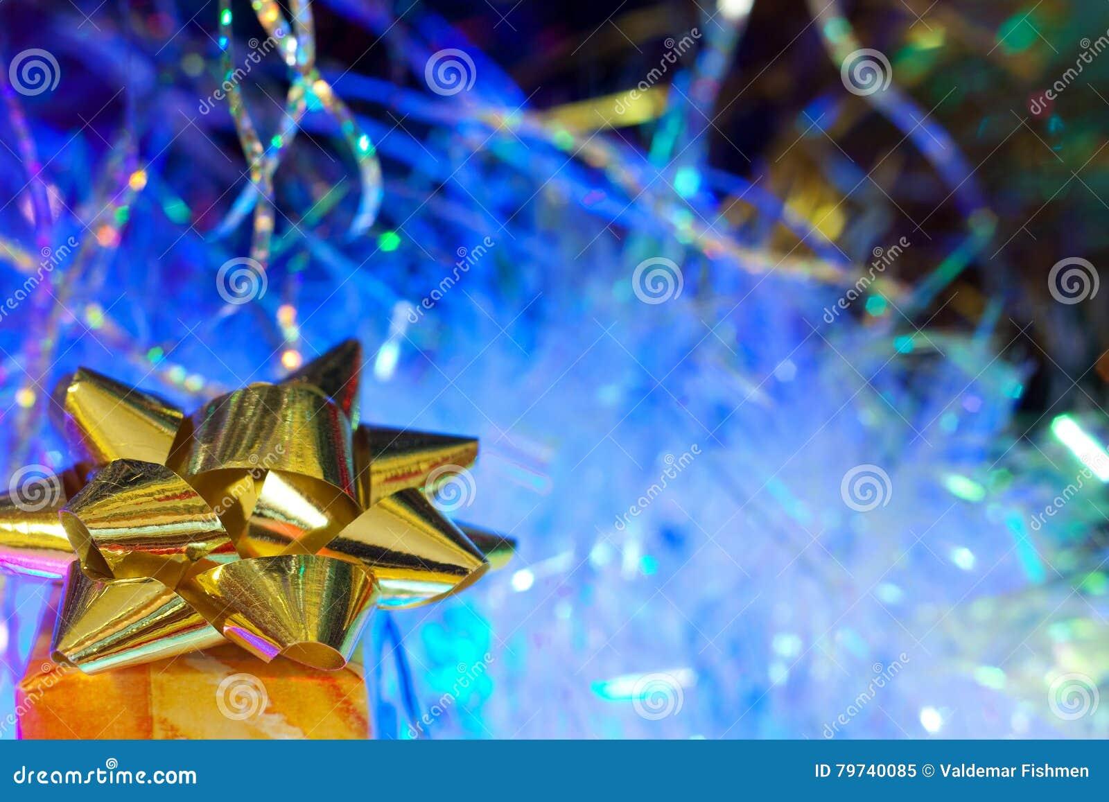 Regalo del oro del fondo del Año Nuevo y de la Navidad