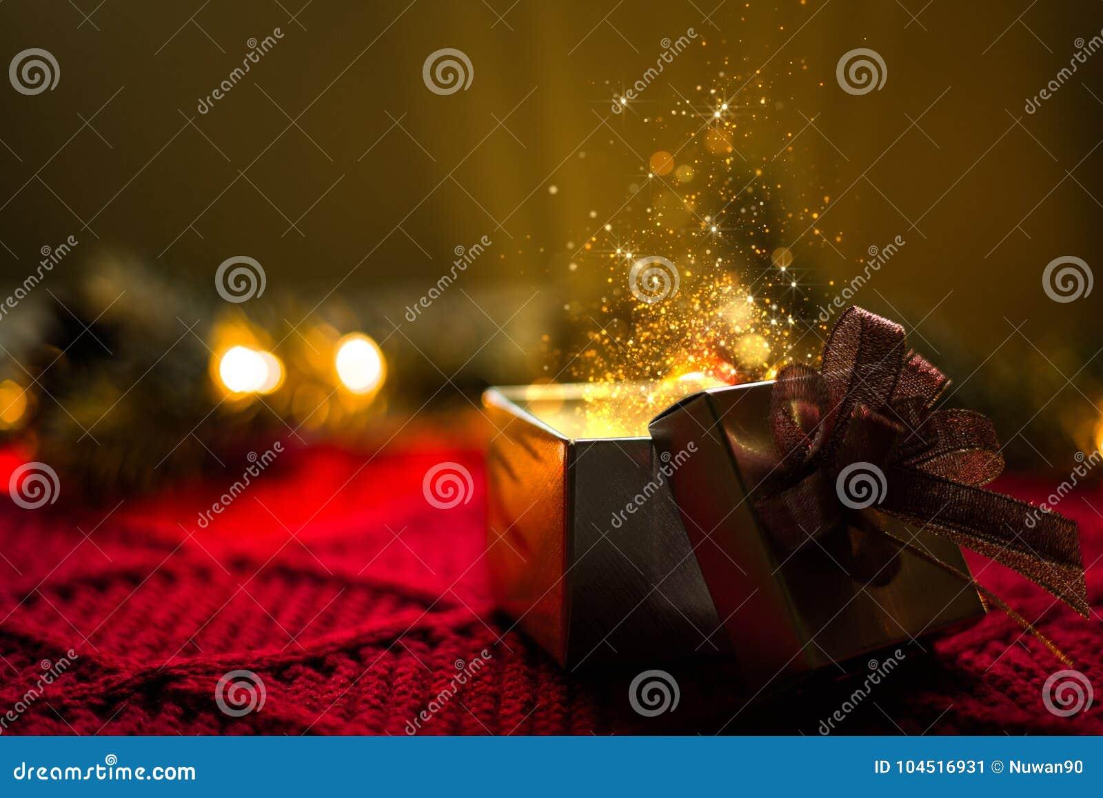 Regalo di Natale con le luci di magia delle particelle dell oro