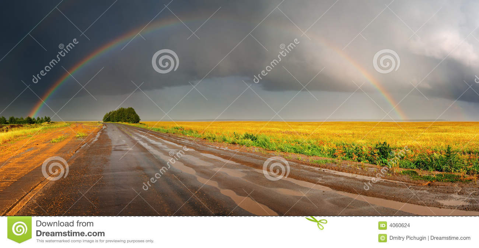 Regenboog over weg