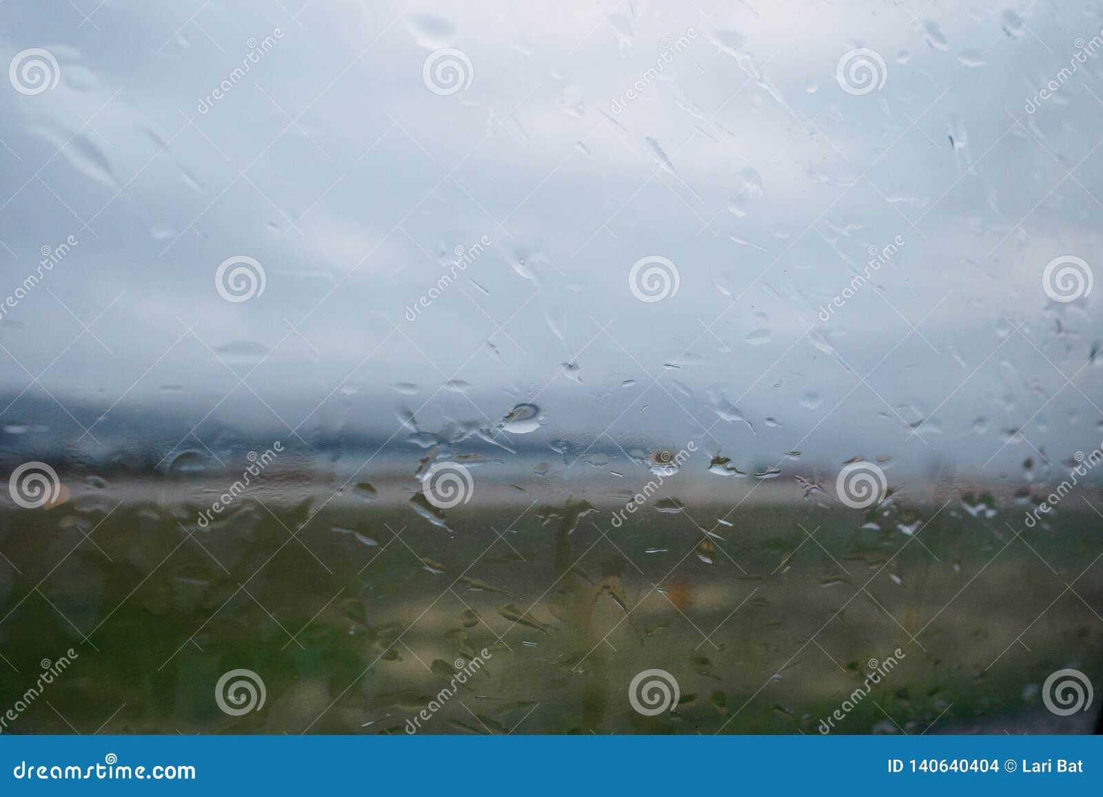 Regendruppels op het glas Achtergrond