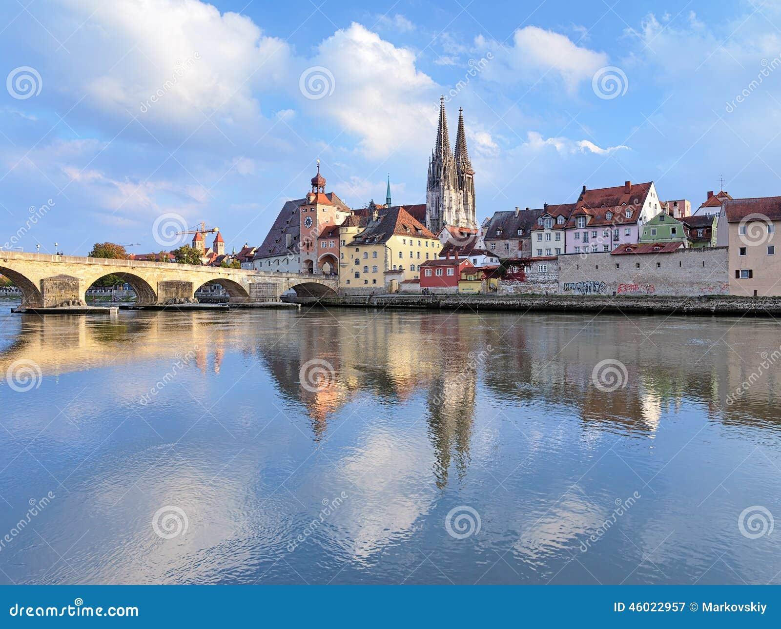 Regensburg cathedral and stone bridge in regensburg germany stock