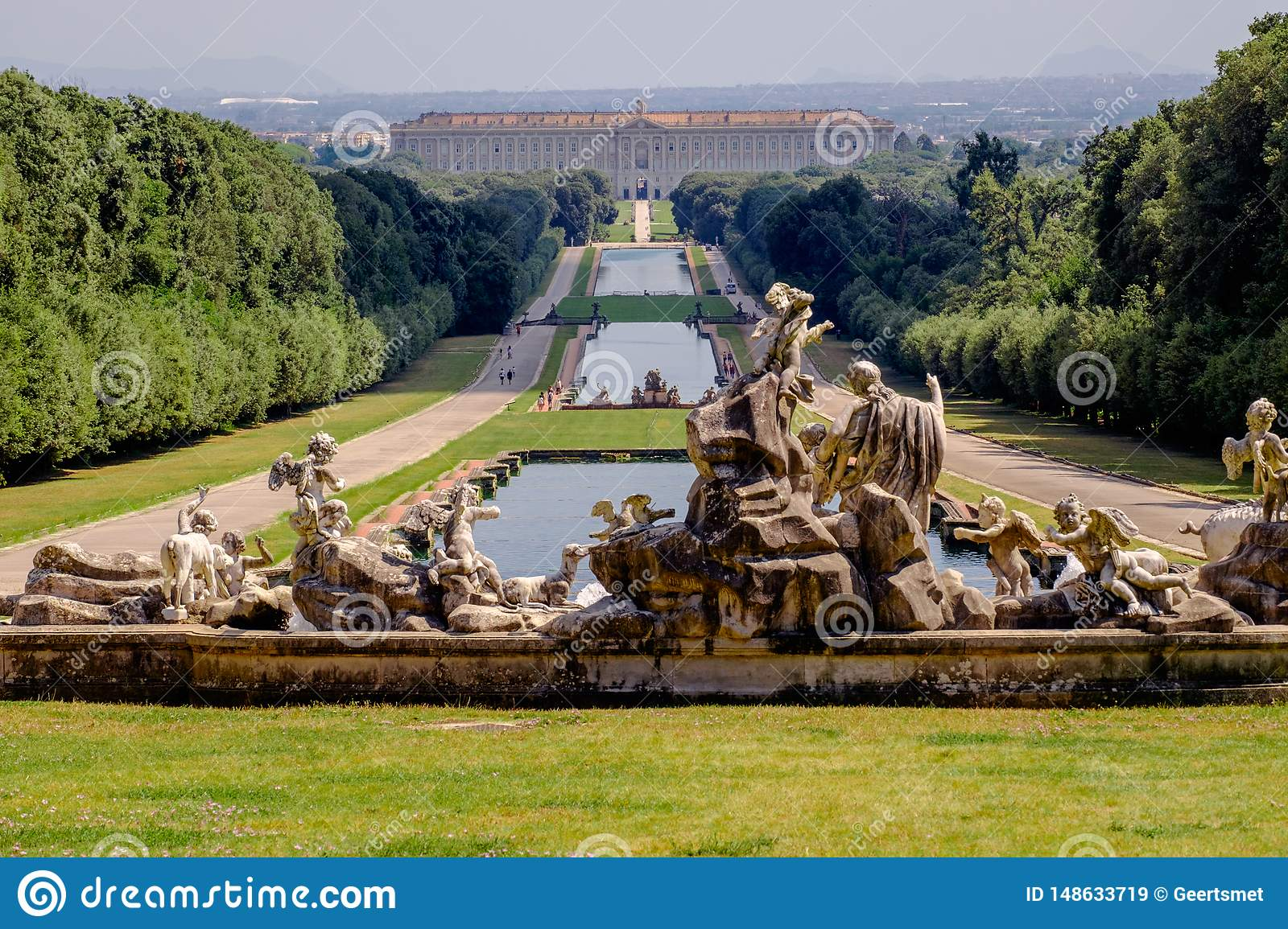 Statues and water bassins in the huge royals gardens of the `Reggia di Caserta`