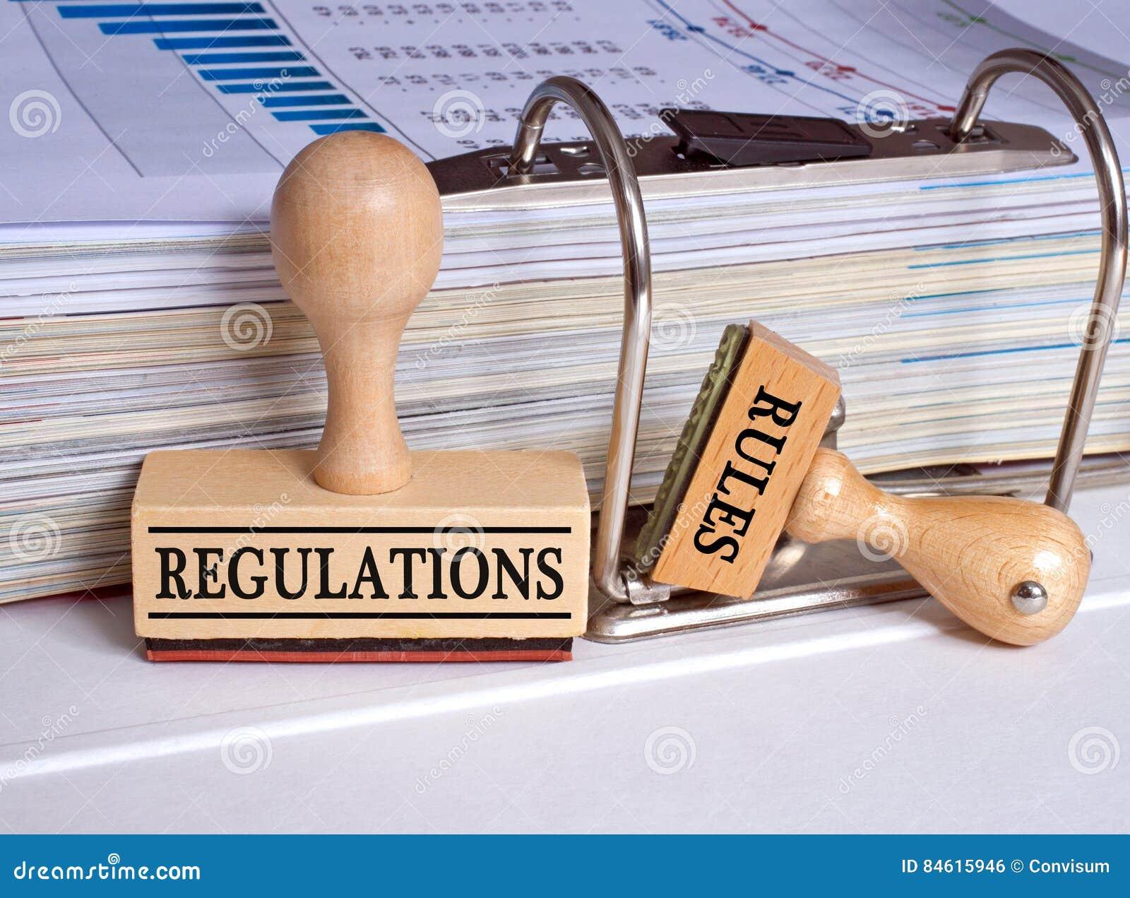 Regulamentos e regras - dois selos no escritório