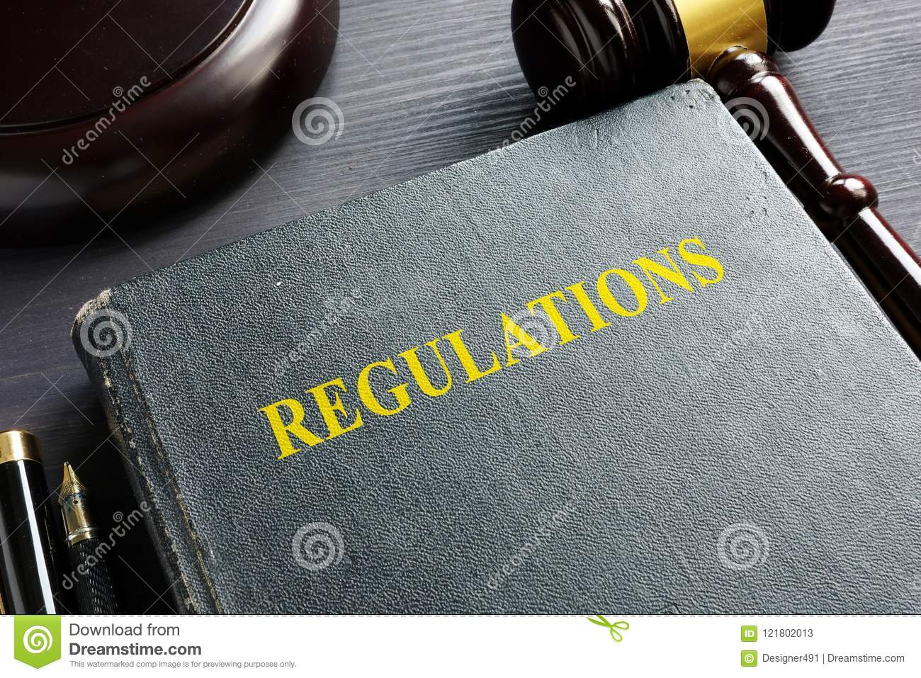 Regulations book and gavel. Law concept.
