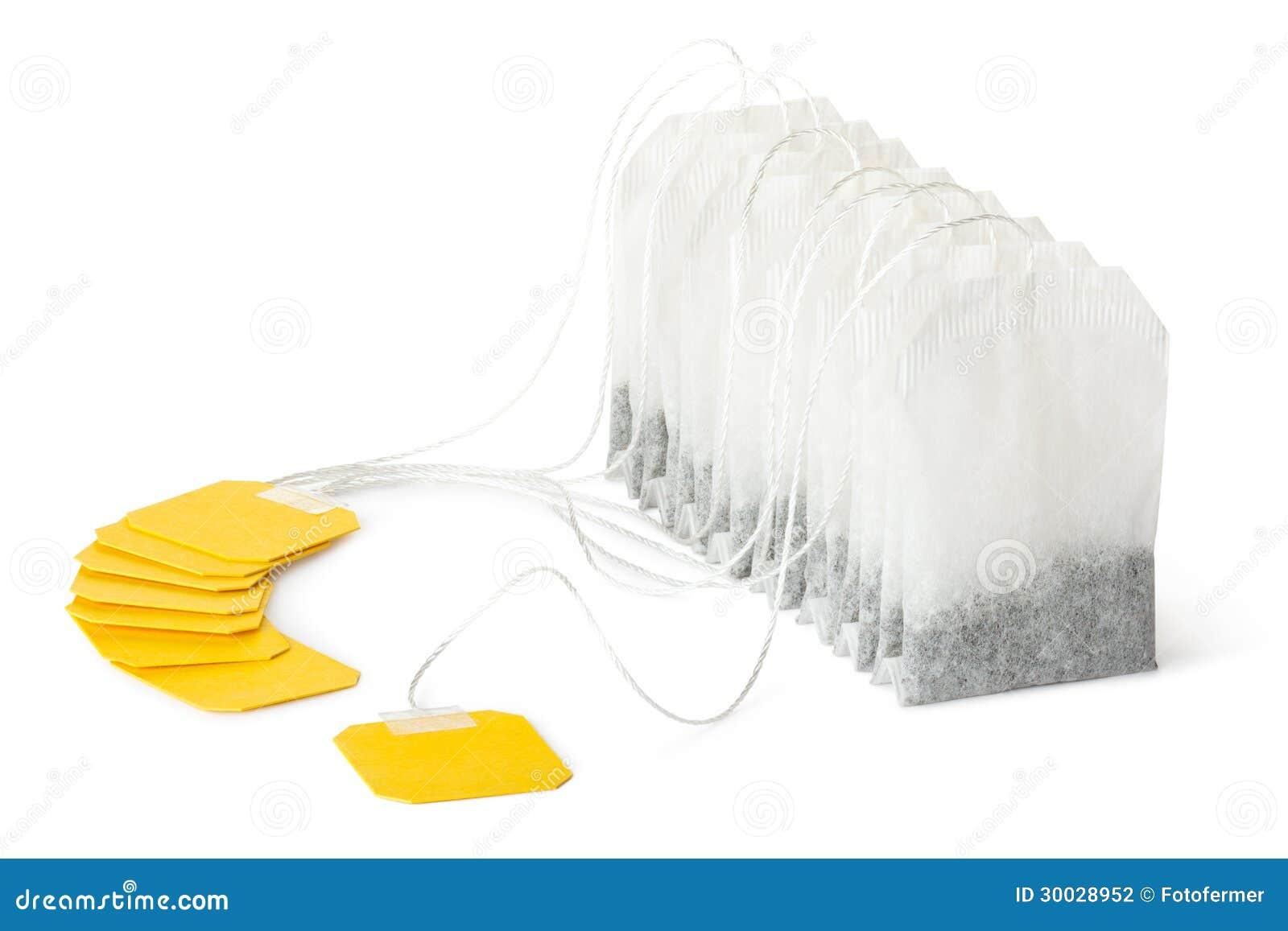 Reihe Der Teebeutel Mit Gelbem Aufkleber Stockfotografie