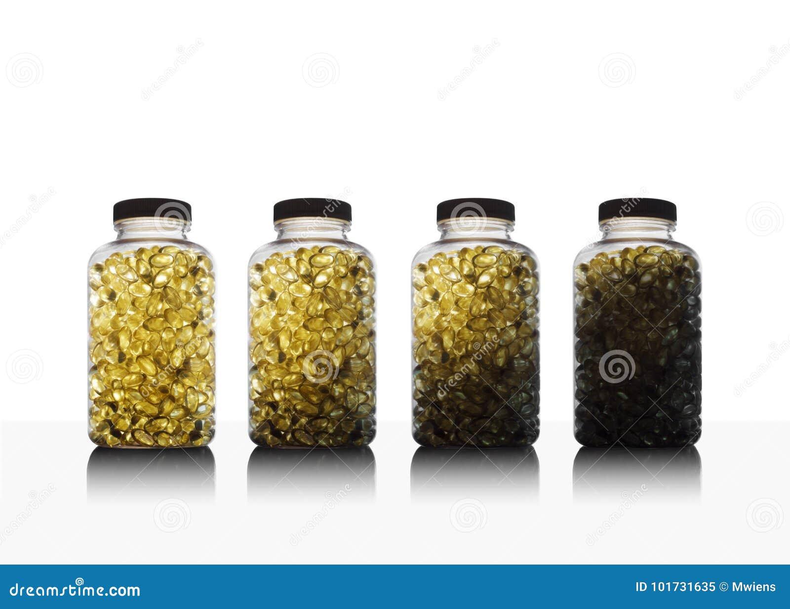 Reihe von Flaschen voll des Fischöls Omega 3 und des Vitamins D