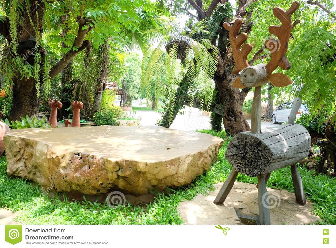 Reindeer in the garden stock image image of idea stone for Garden sit out designs