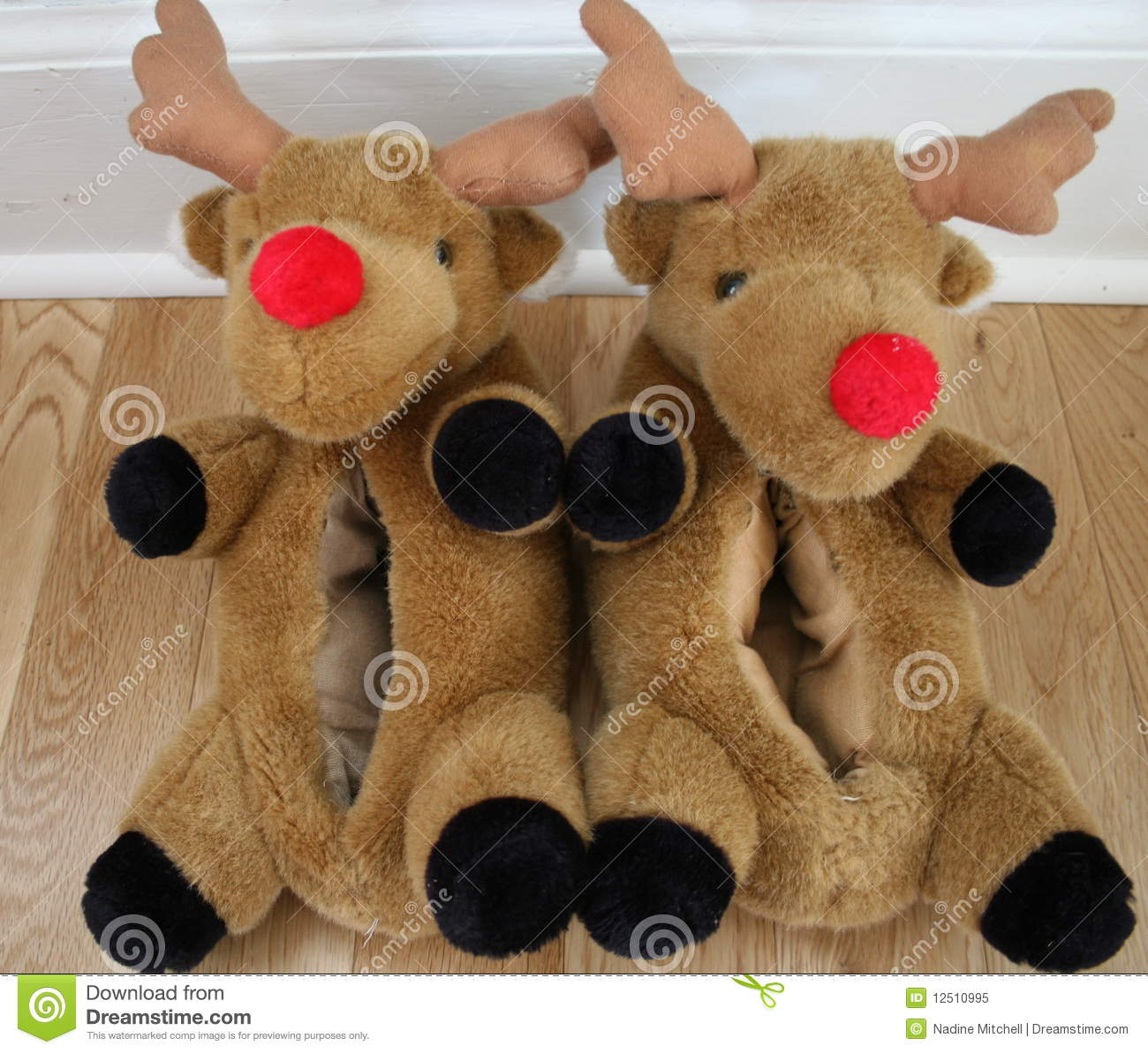 c110cb0212a Reindeer slippers with red noses worn by children and adults