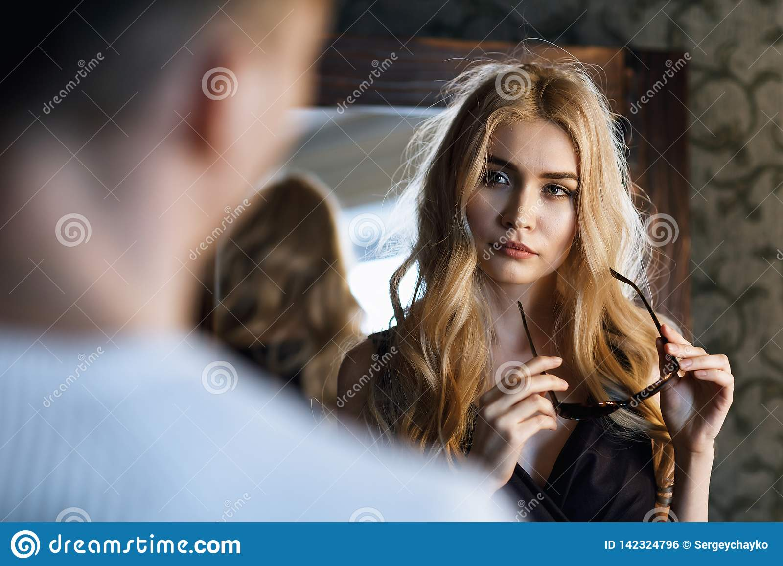 The relationship between a man and a woman. Young beautiful girl looks at her friend