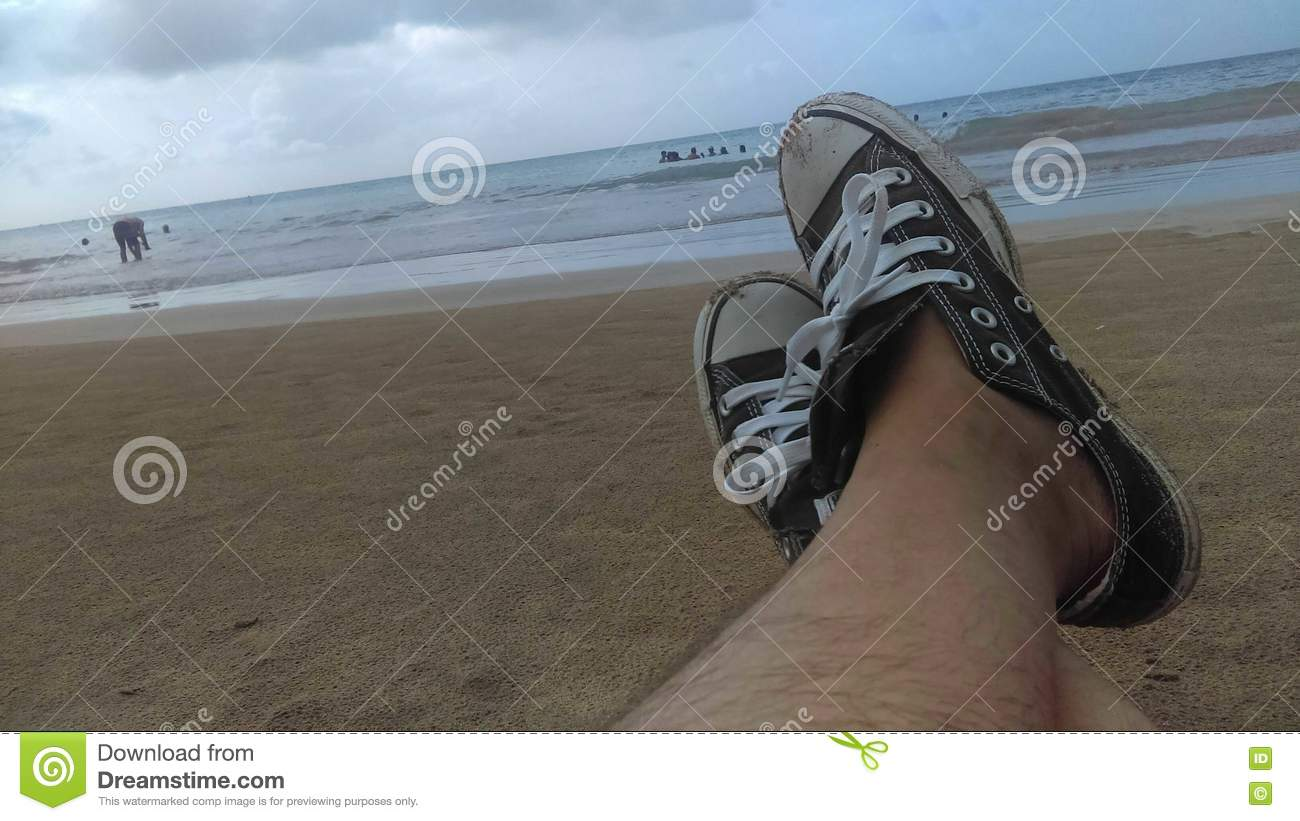 9a9b4ff04b0d Relax At The Beach With Converse sneakers Stock Image - Image of ...