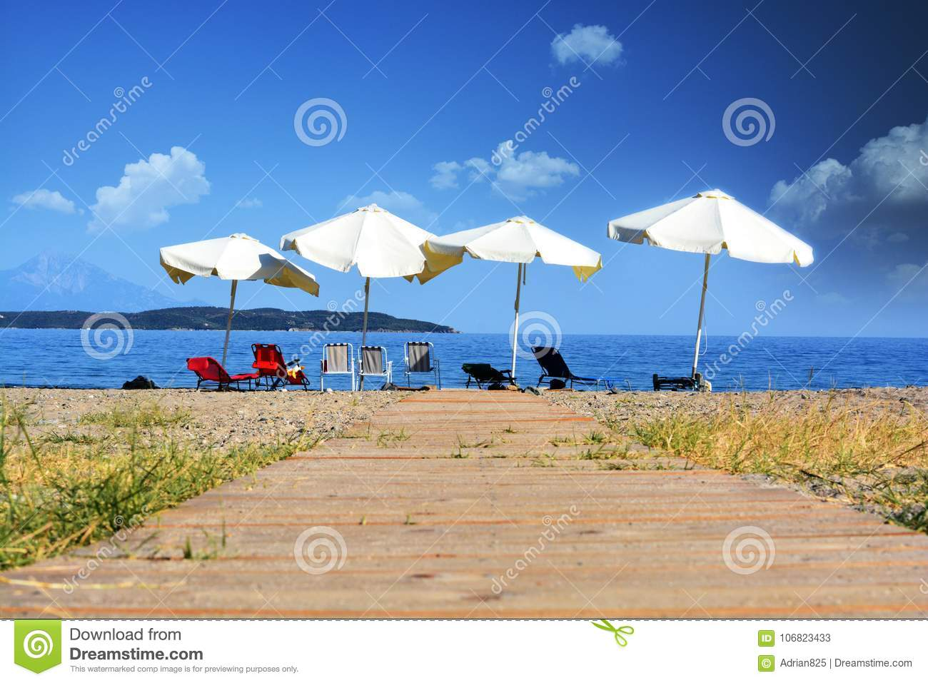 Relax concept, empty beach with parasols and chairs