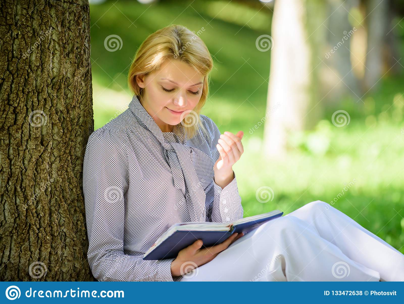 Relax leisure an hobby concept. Best self help books for women. Books every girl should read. Girl concentrated sit park