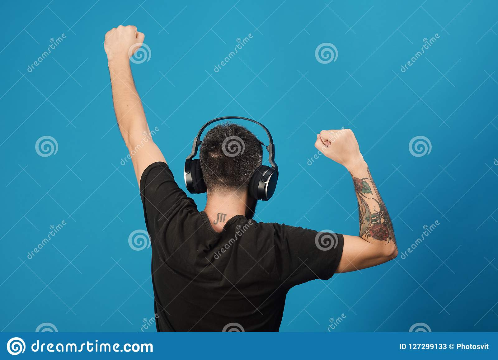 Relax and music concept. Dj with scorpio tattoo wears headphones