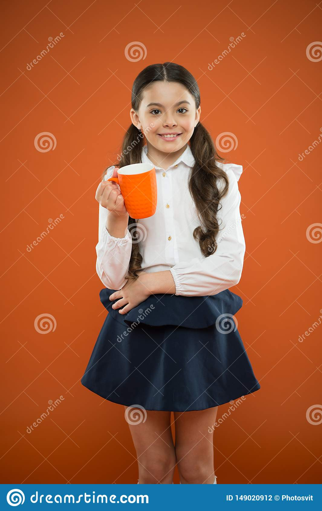 Relax and recharge. Water balance. Enjoying tea before school classes. Drink enough water. Inspiring drink. Girl drink
