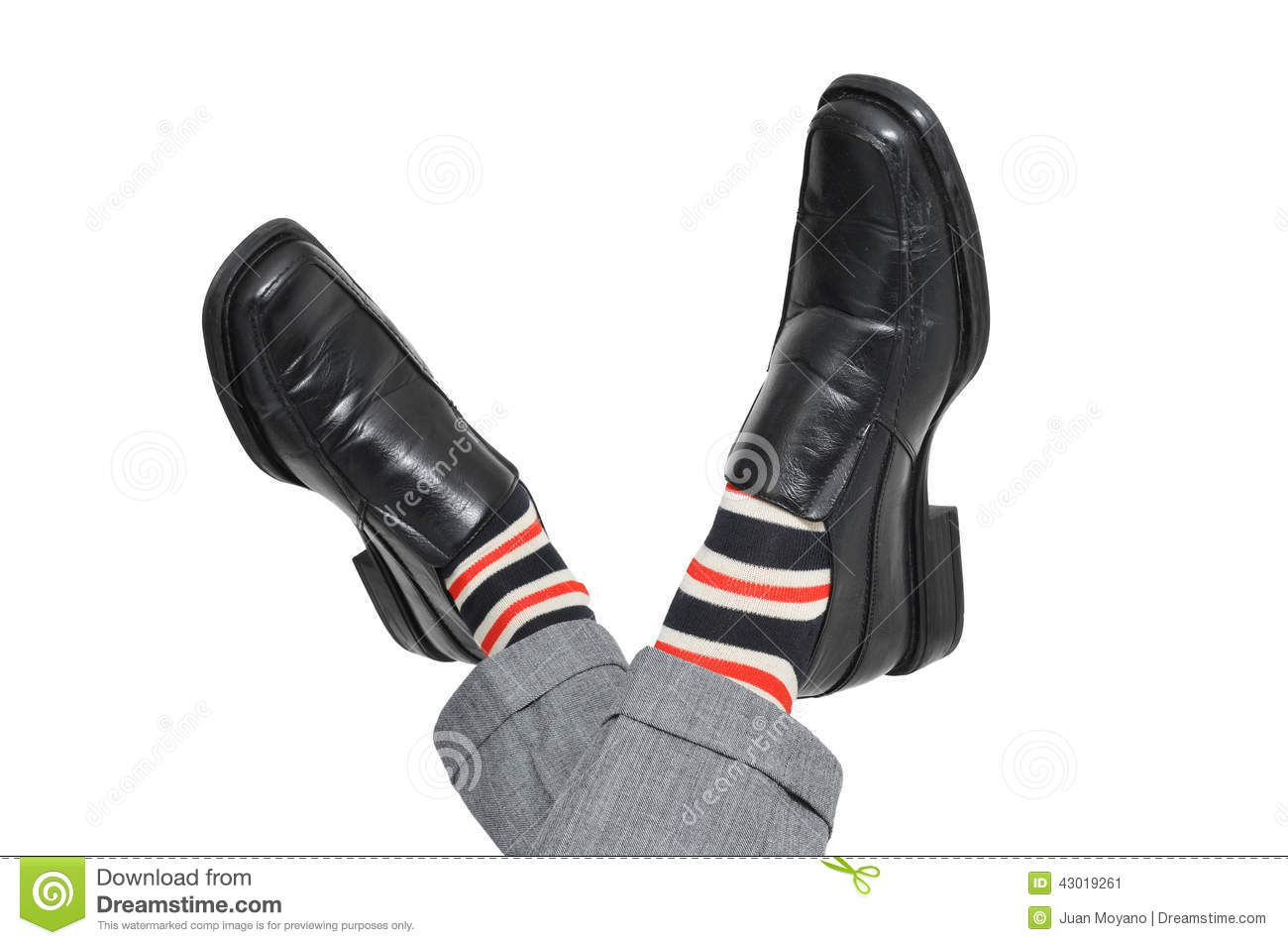 Relaxed businessman crossing his feet