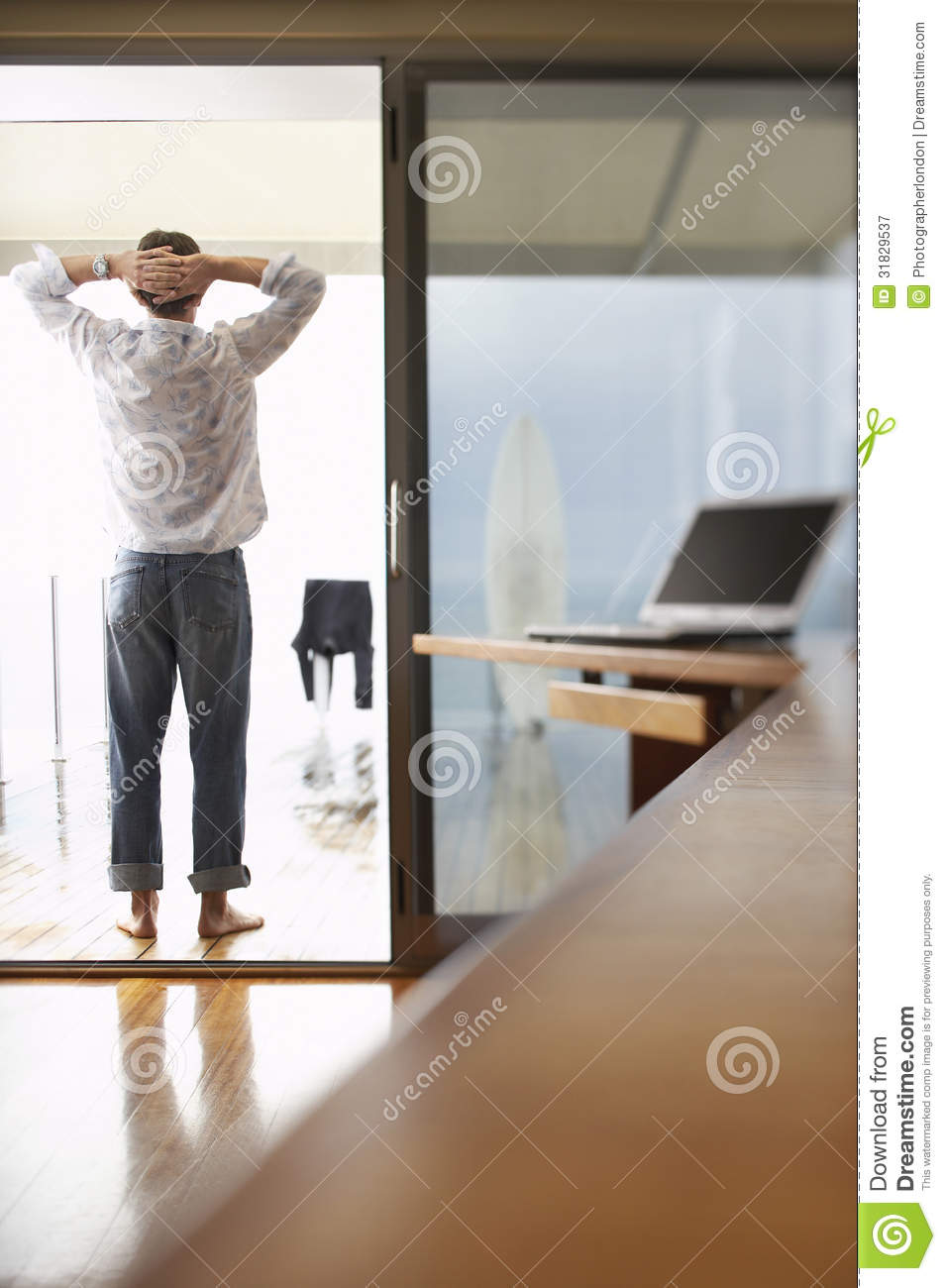 Relaxed Businessman Standing On Balcony Stock Image
