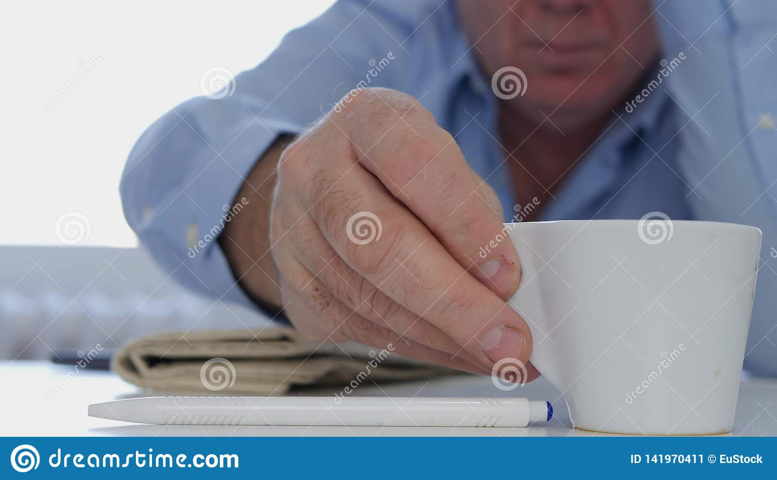 Relaxed Businessman in Working Pause Drinking a Fresh and Tasty Hot Coffee