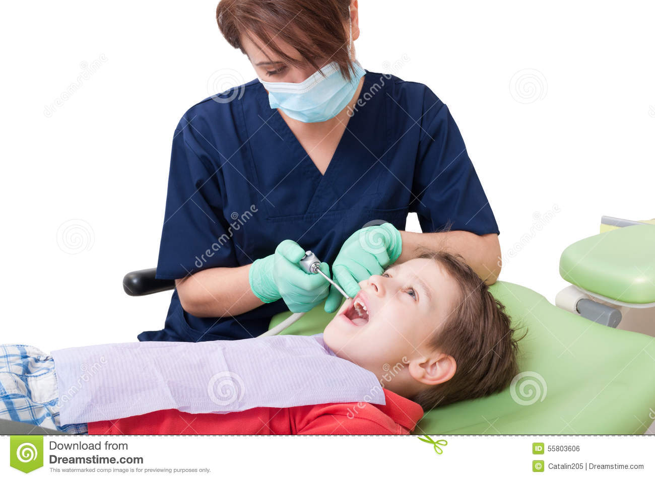 Relaxed kid on dentist chair with women doctor at periodic checkup