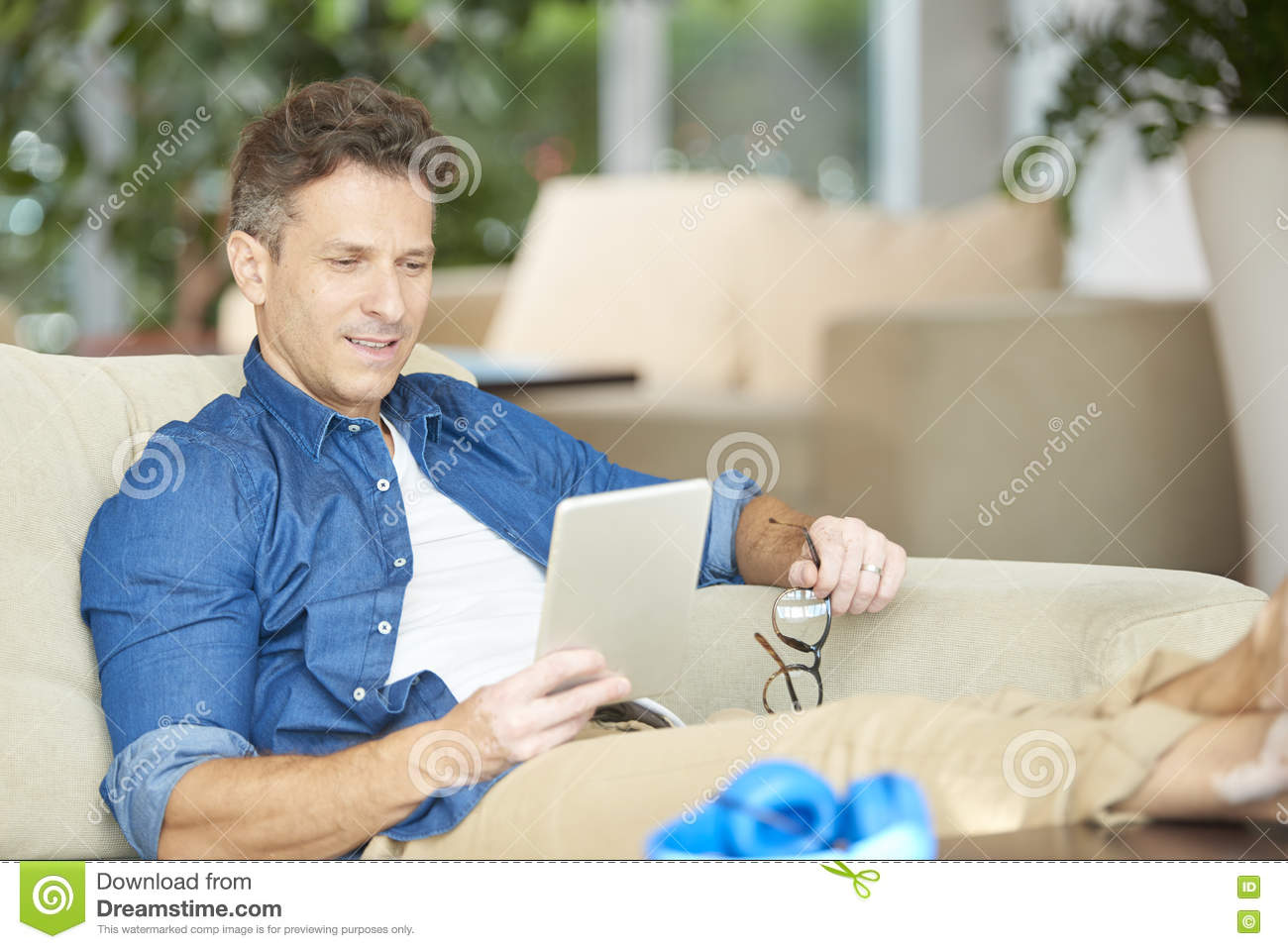 Relaxed man with digital tablet