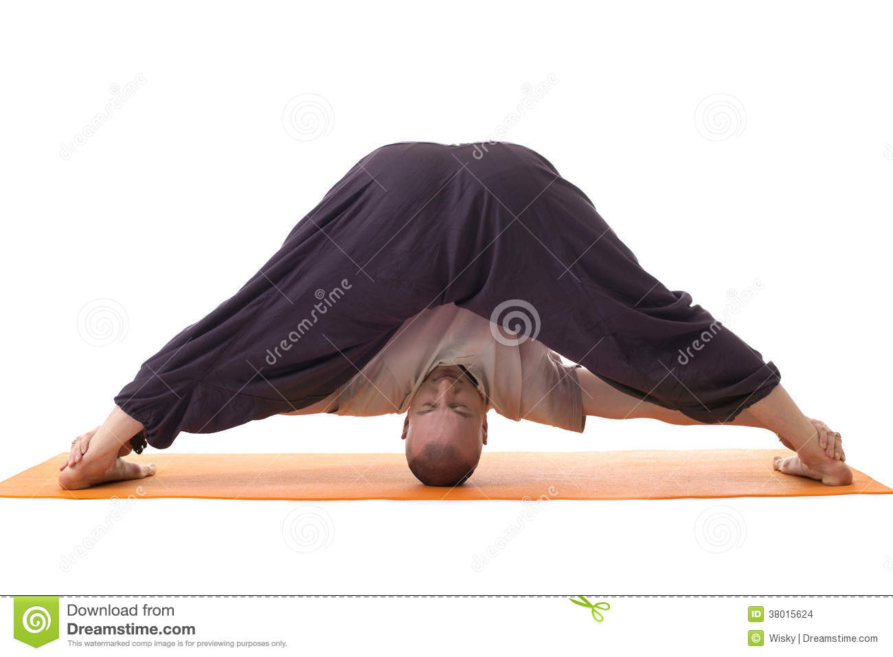 Relaxed Man Posing In Difficult Yoga Pose Stock Photo