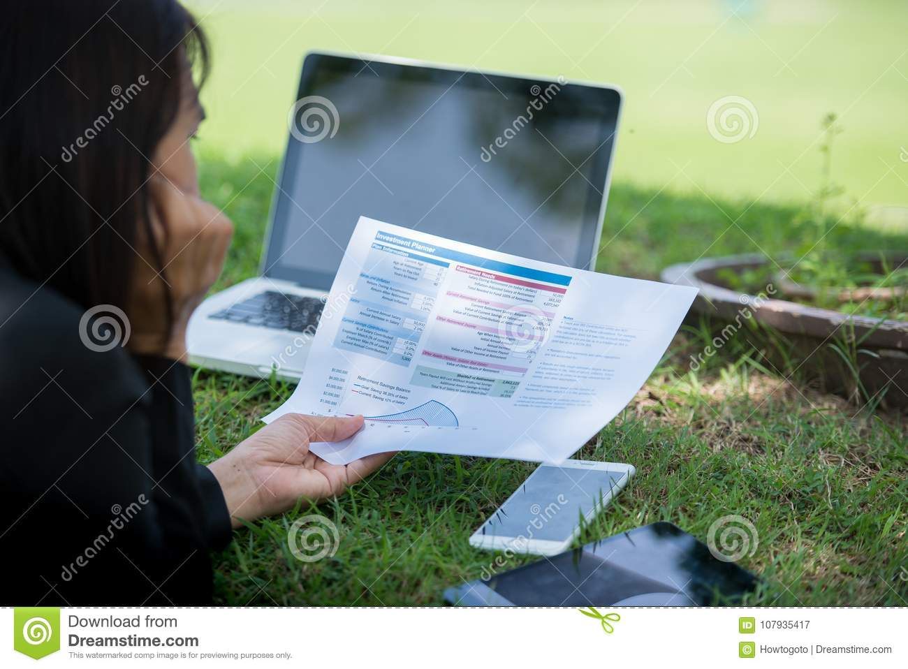 Relaxed Sales Managers Working Outdoor. Working Woman Showing Hand Market Report Charts