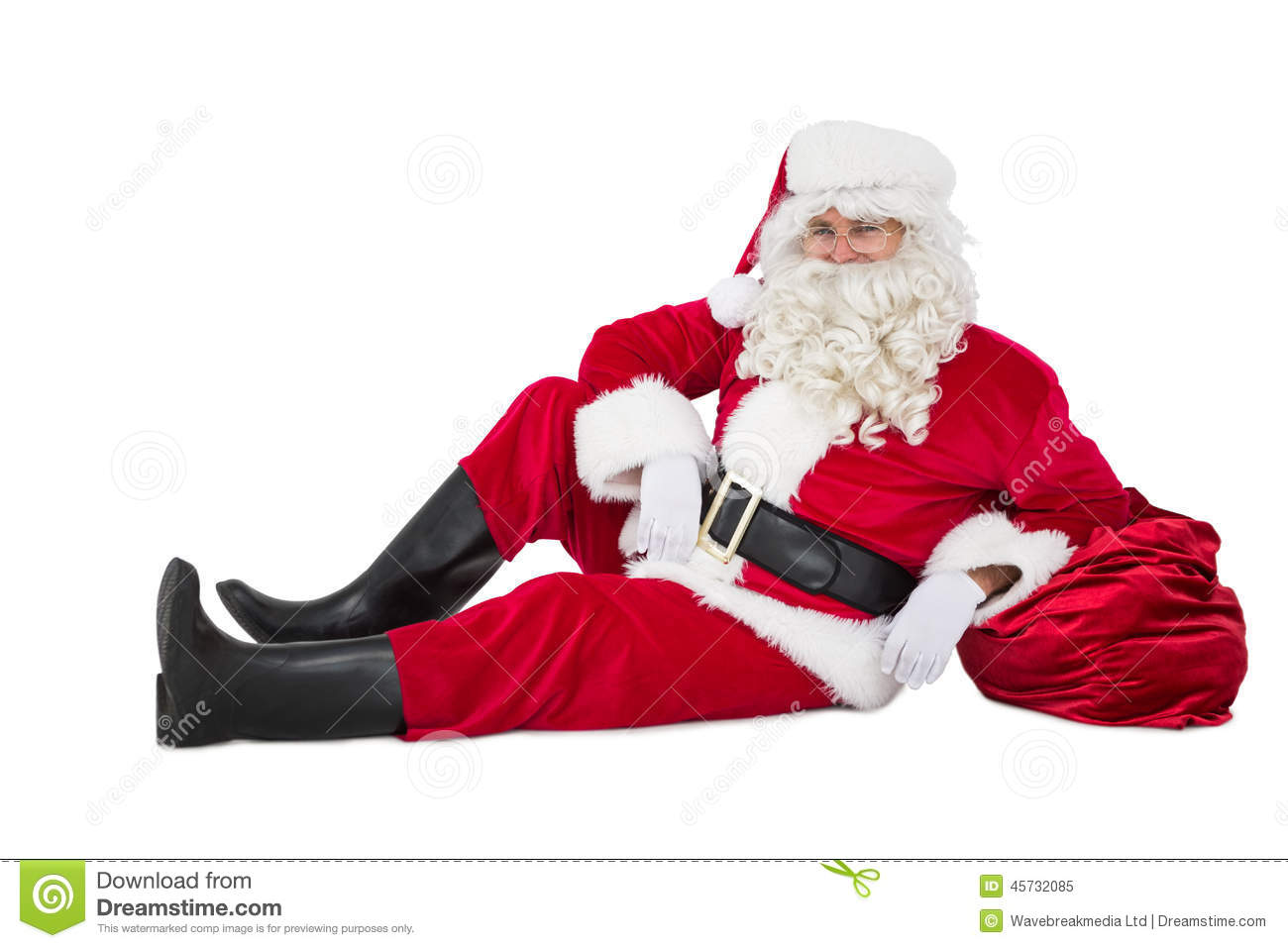 Relaxed Santa Sitting And Leaning On His Sack Stock Photo