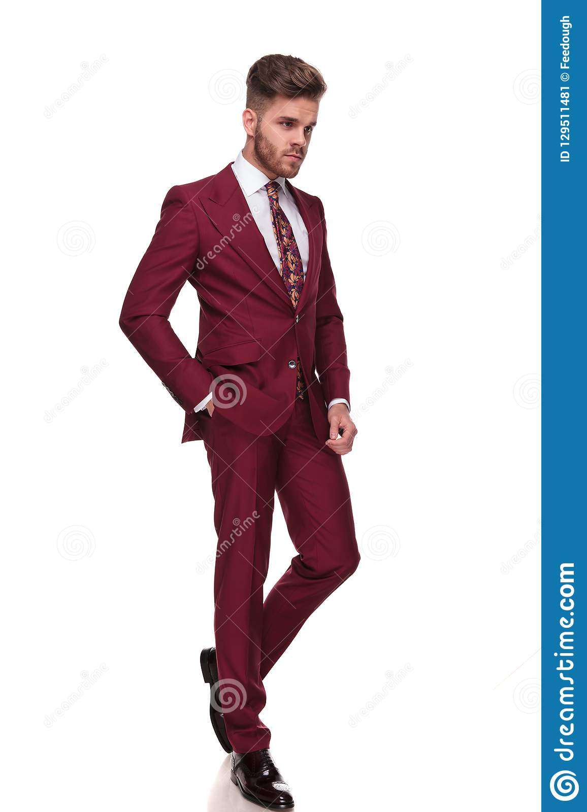 Relaxed stylish man walks and looks down to side