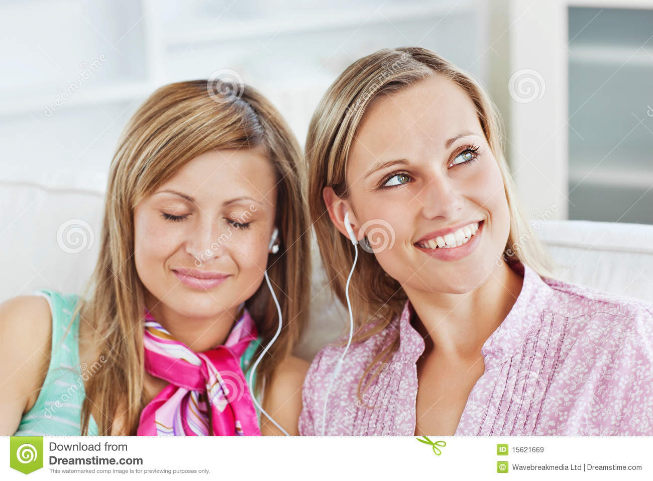 Relaxed Two Female Friends Listening To Music Royalty Free ...
