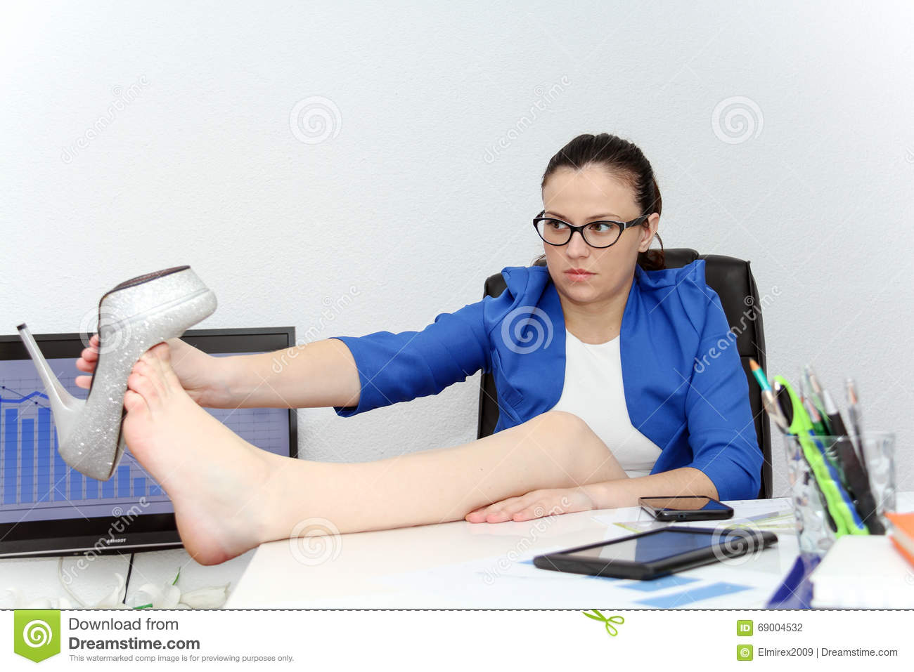 Relaxed And Winning Business Woman Sitting With Her Legs