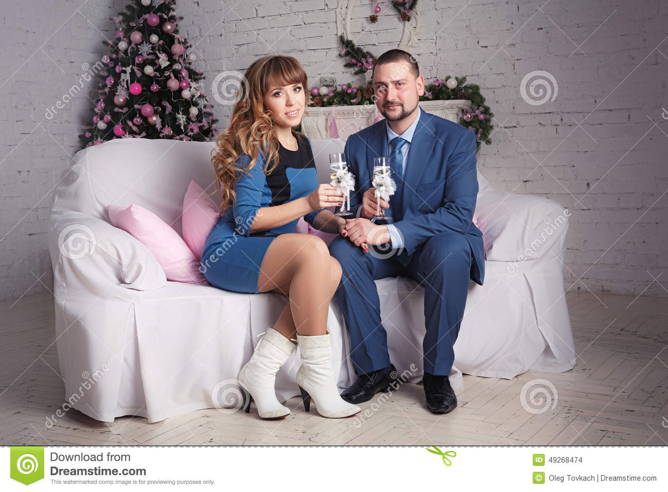 Relaxed young couple at home in bright living room with for Living room ideas young couples
