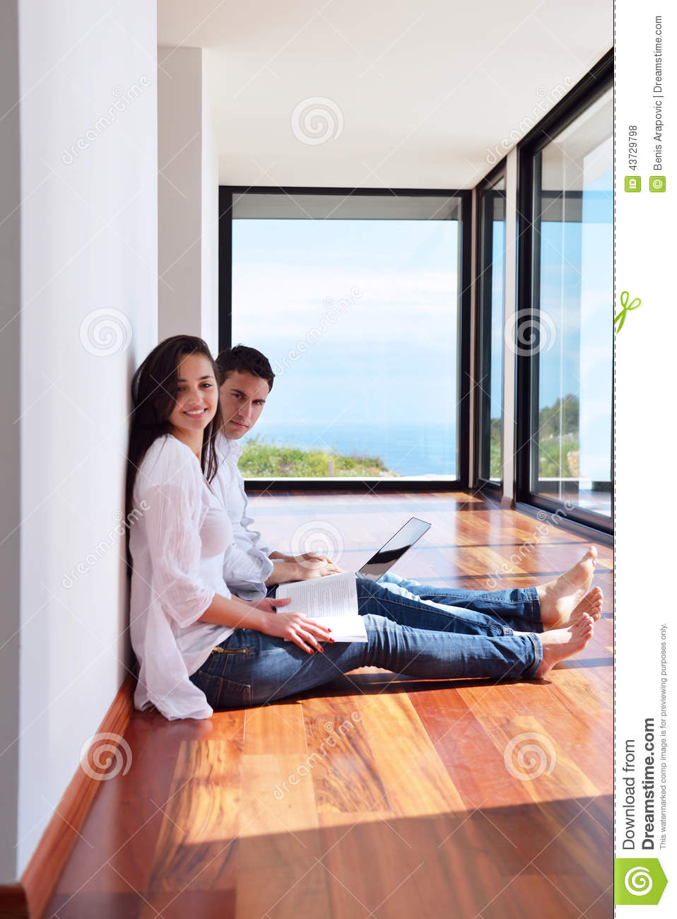 Relaxed young couple working on laptop computer at home stock photo image 43729798 - Young couple modern homes ...