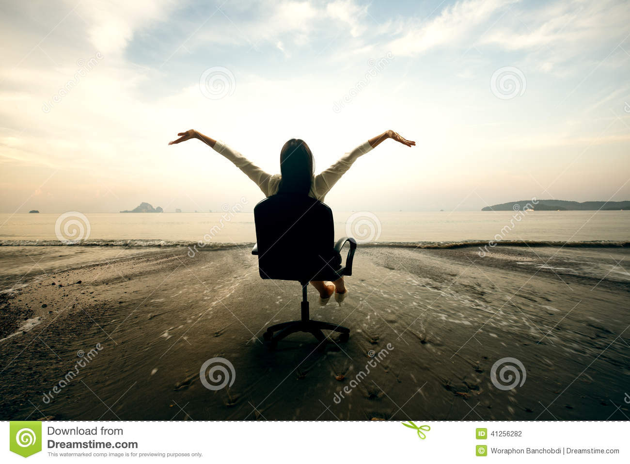 Relaxing business woman sitting on beach