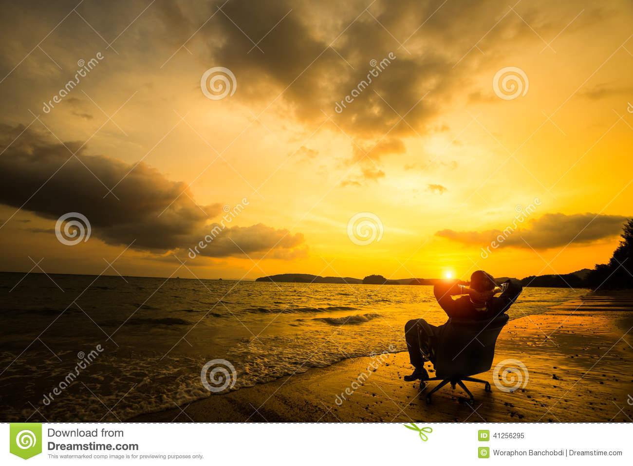 Relaxing businessman sitting on beach