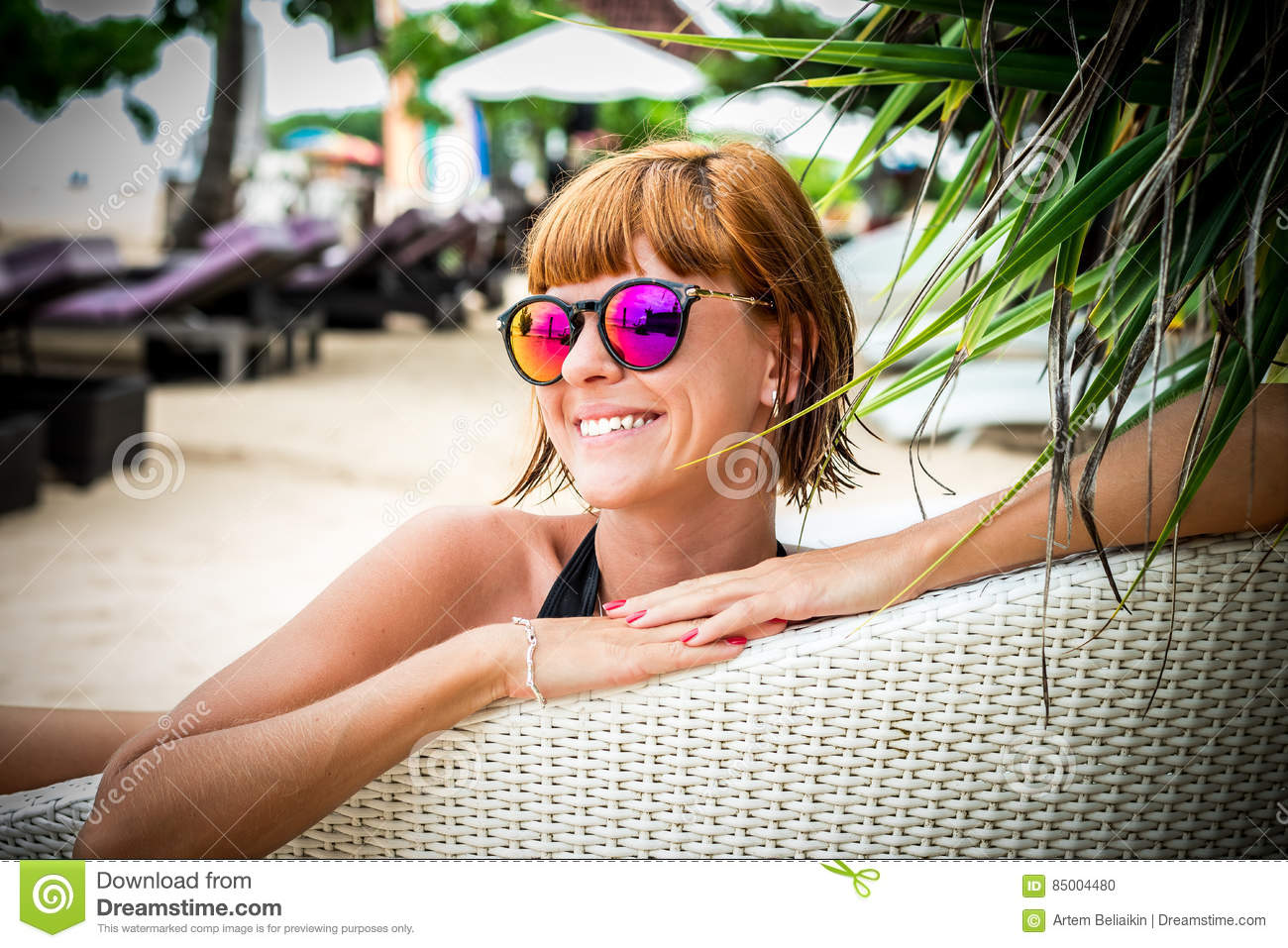 197e32fa46 Relaxing On The Deck Chair. Beautiful Young Women In Sunglasses ...