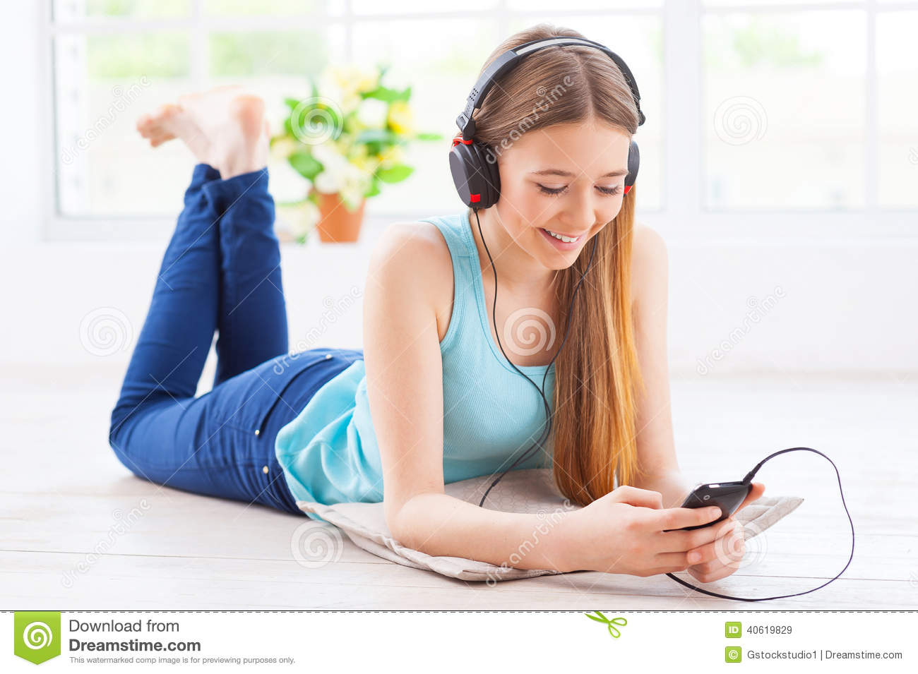 Relaxing with her favorite music stock image image for Down to the floor