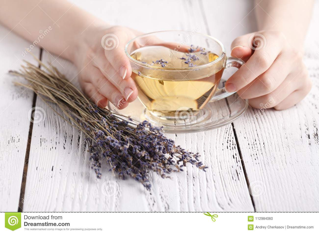 Relaxing herbal tea with lavender in hands