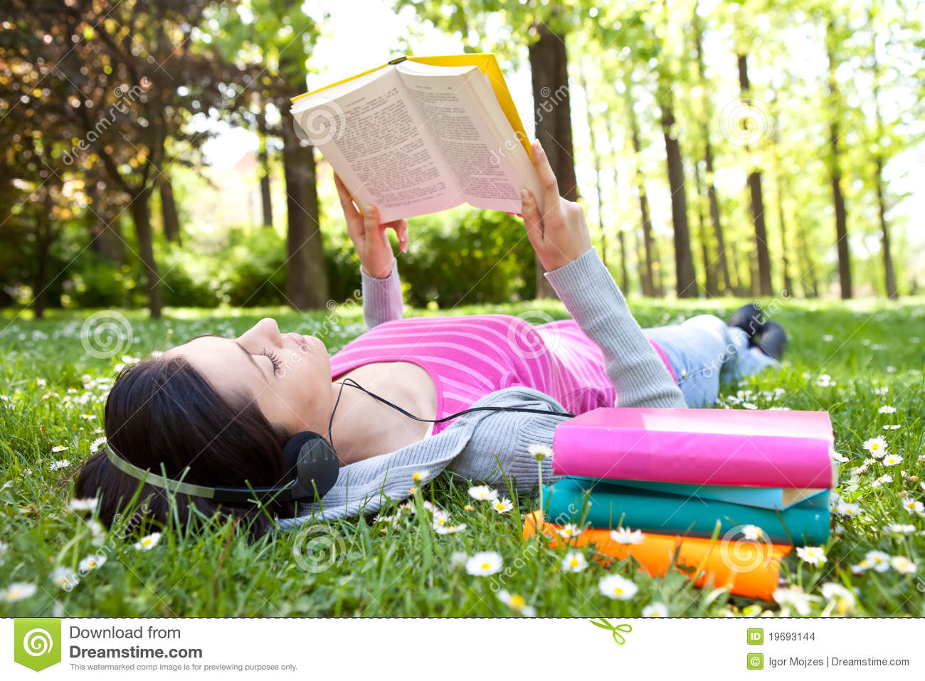 Relaxing in nature with book and music