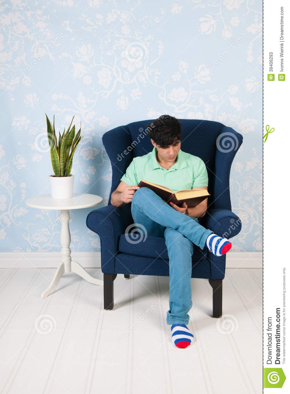 Relaxing and reading at home stock photo image 39406293 for Sitting in armchair