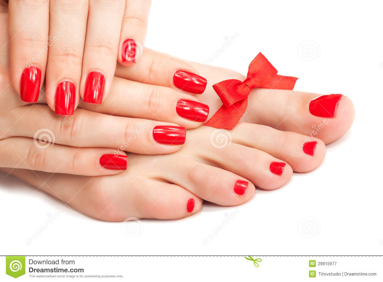 Red Manicure And Pedicure With A Bow Royalty Free Stock