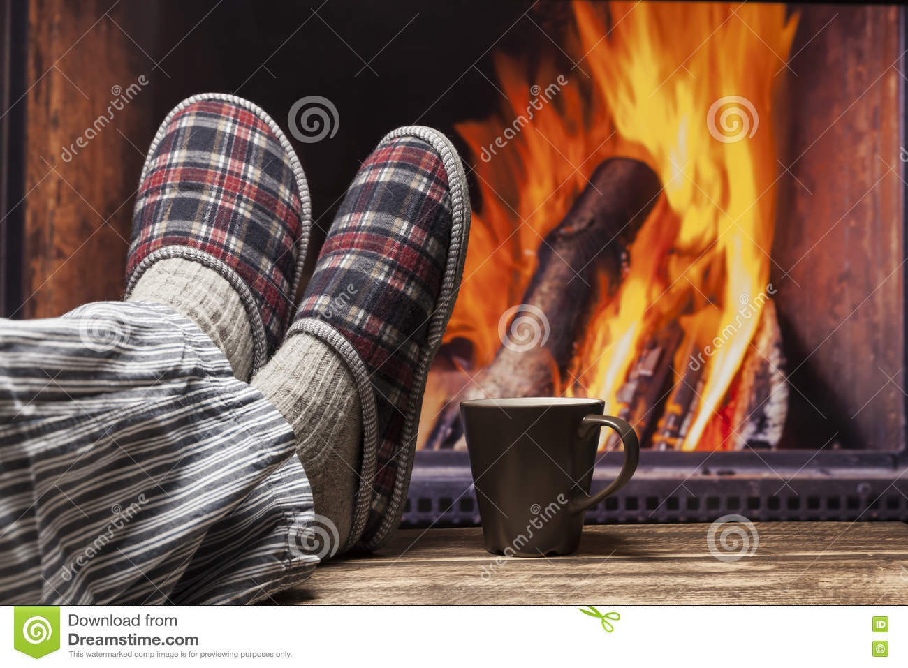 relaxing in slippers at fireplace stock photo image 76620754