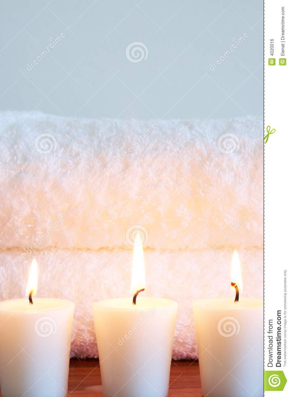 Relaxing spa scene with towels and candles