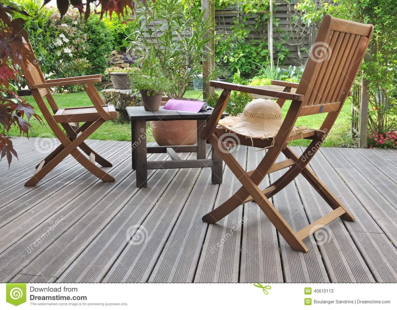 Relaxing in terrace stock photo image 40610113 for Chaise transparente table bois