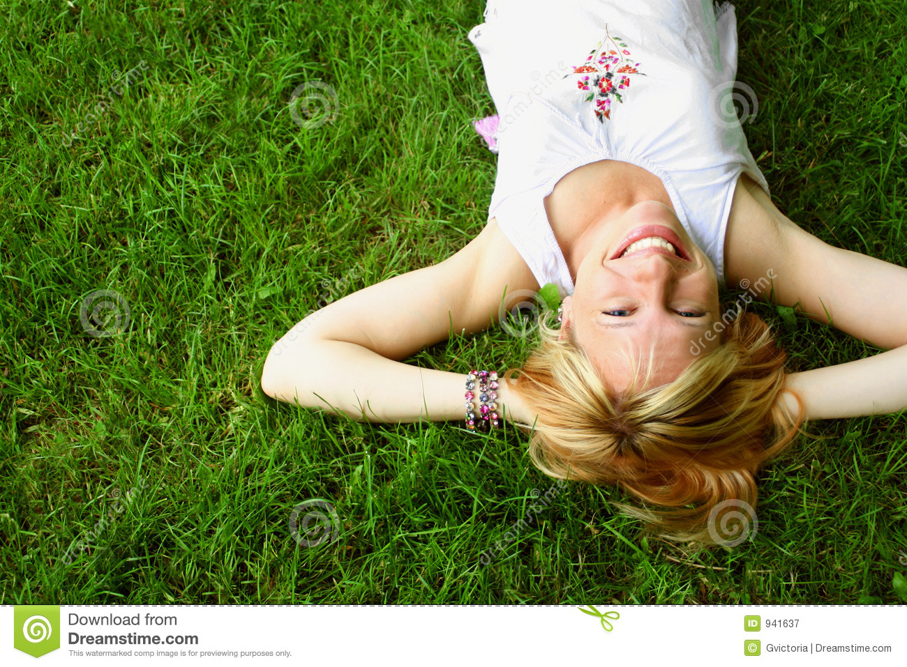 Relaxing woman laying on grass