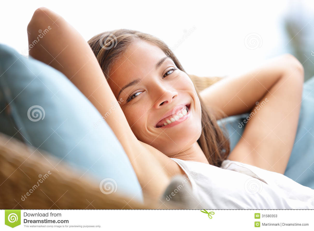 Relaxing woman sitting comfortable in sofa