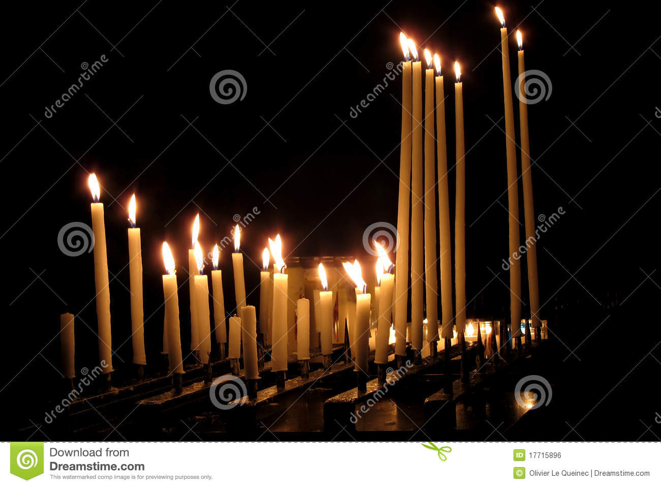 Religious Candles Burning in a Dark Church